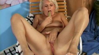 Lustful blonde grandmother Leona fucking a dildo hard